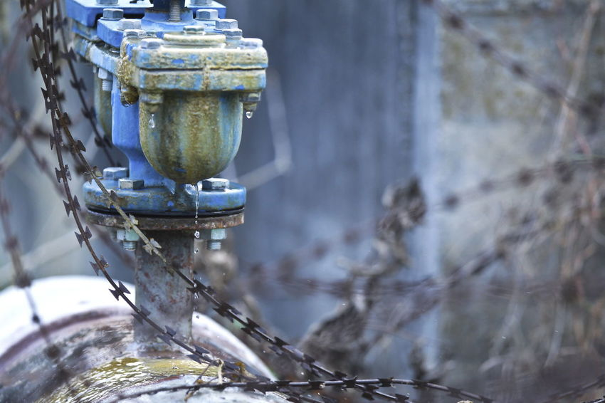Close up a main valve pipe leaking Architecture Built Structure Close-up Container Day Electric Lamp Flowing Water Focus On Foreground Household Equipment Lighting Equipment Metal Motion Nature No People Outdoors Plant Reflection Selective Focus Still Life Tree Water