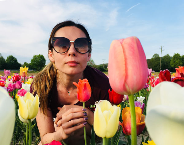 Visual Creativity Beauty In Nature Day Fashion Flower Flower Head Flowering Plant Fragility Front View Glasses Hairstyle Leisure Activity Lifestyles Nature One Person Outdoors Plant Portrait Real People Sky Sunglasses Vulnerability  Young Adult Young Women
