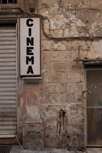 Low angle view of sign on wall of old building