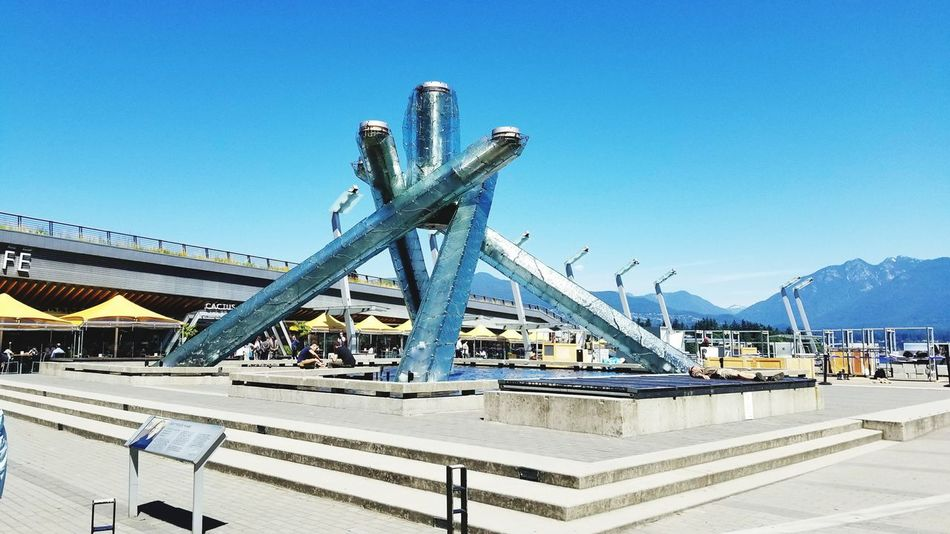 Olympic torches on Vancouvers waterfront. Outdoors Blue Built Structure Torches Olympic Architecture