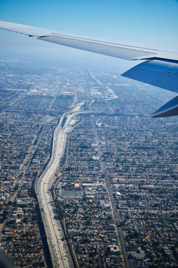 Landing Airplane over Los Angeles Aerial View Airplane Transportation Air Vehicle City Mode Of Transportation Cityscape Aircraft Wing Flying Architecture Sky Day No People High Angle View Landscape Los Angeles, California Airplane Landing