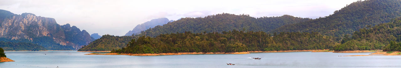 View of Mountain at Cheow Lan Dam (Ratchaprapa Dam) Surat Thani, Thailand Water Tree Mountain Scenics - Nature Sky Nature Beauty In Nature Plant Lake Tranquility Tranquil Scene Panoramic Animals In The Wild Nautical Vessel Animal Themes Animal Wildlife Transportation Land Animal No People Outdoors Cheow Lan Dam Ratchaprapa Dam Dam Surat Thani