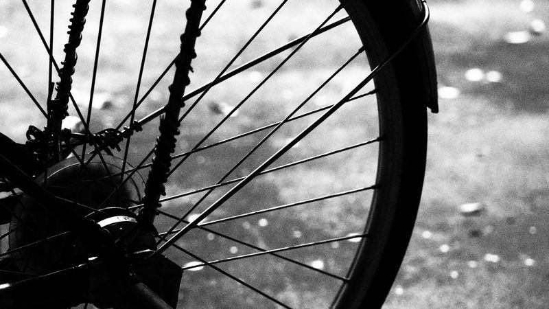Black and white bicycle wheel and grunge texture Bicycle Bicycle Wheel Blackandwhite Dark Day Grunge Let's Go. Together. Light And Shadow Mood Outdoors Shades Shades Of Grey Street