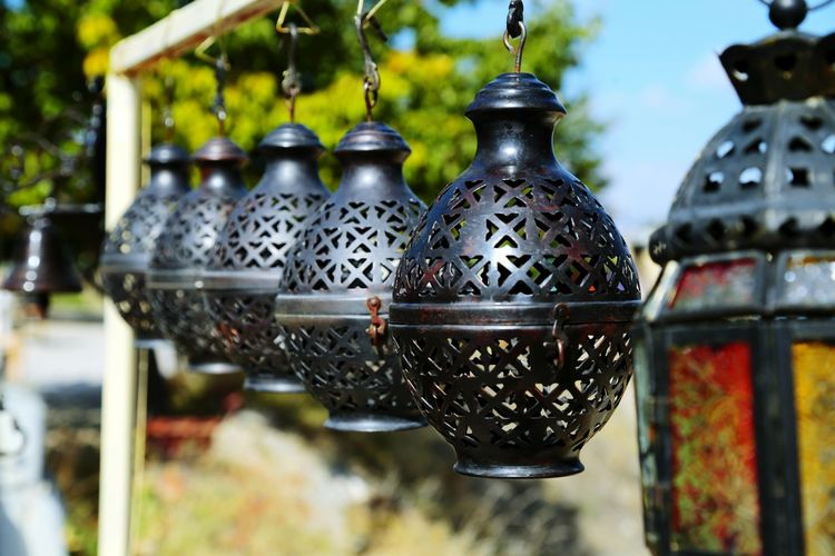 Close-up of hanging lamps against blurred background