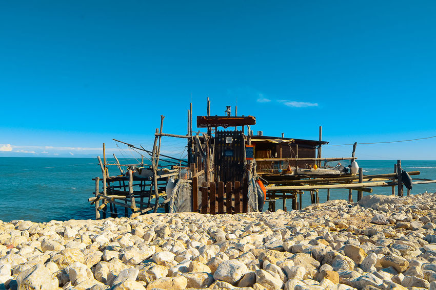 Architecture Beach Blue Built Structure Clear Sky Day Horizon Over Water Nature Nautical Vessel No People Outdoors Pebble Pebble Beach Rock - Object Sea Sky Trabocchi Coast Trabocco Water
