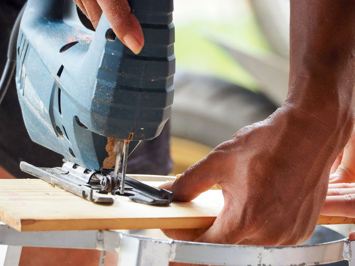 Cropped Hand Of Carpenter Working In Workshop