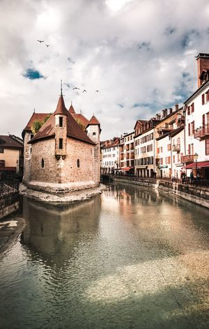 The magic Annecy Annecy, France Castle Frenchvillage Landscape_Collection Travel Photography Travel Destination Bird Water Sky Architecture Building Exterior Cloud - Sky Built Structure Storm Cloud Flock Of Birds Cloudscape Dramatic Sky Atmospheric Mood