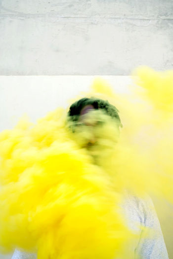 Young black man with a yellow smoke