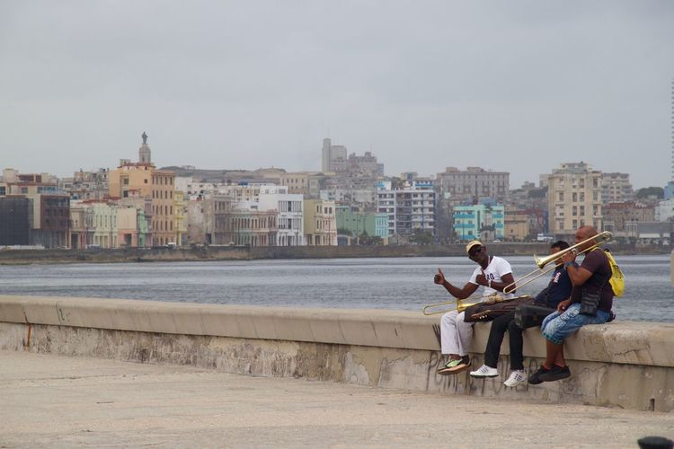 Cuba El Malecon Habana Havana Havanna, Cuba Malecon Promenade Sitting Outside City Cuban Life Friendship Full Length Leisure Activity Malecón, La Habana Men Music Musical Instrument Only Men Real People Relaxation Sea Seafront Seaside Sitting Young Adult Been There. Stories From The City This Is Latin America
