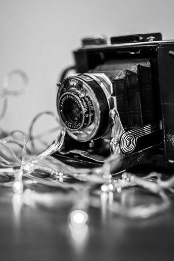 vintage Kodak Black And White Photography Black And White monochrome photography Monochrome Vintage Camera Fairy Lights Kodak Camera Kodak Film Kodak EyeEm Selects Indoors  No People Close-up Still Life Technology Selective Focus Retro Styled Camera - Photographic Equipment Antique Arts Culture And Entertainment Photographic Equipment