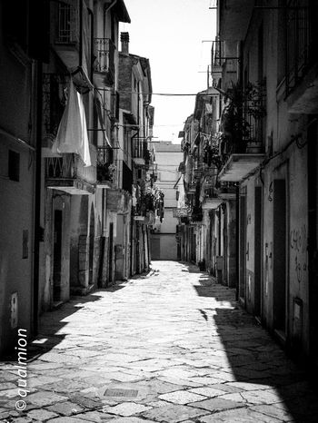 #urbanana: The Urban Playground Ancient City Cobblestone Streets Footpath Street View View Arch Architecture Black And White Building Built Structure Cobblestone Diminishing Perspective Narrow Old Buildings Old City Outdoors Perpective Stone Stone Material Street The Way Forward Town Urban