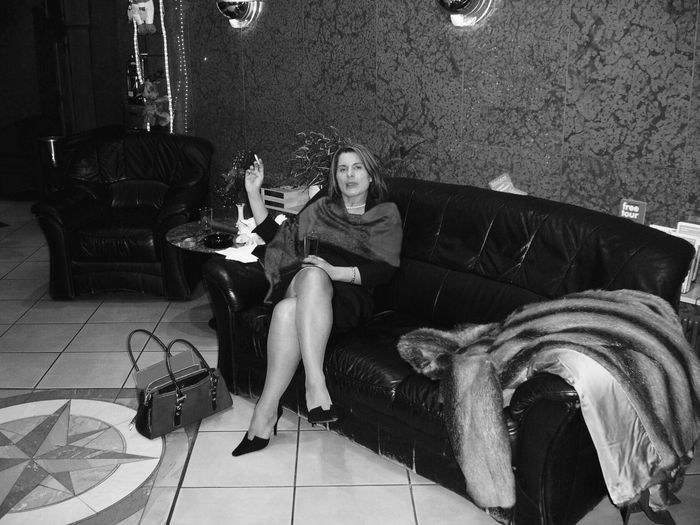 Woman waiting in hotel lobby. Sitting Adults Only Indoors  Front View Social Issues Chair Togetherness People Coffee Table Portrait Germany Smoking Cigarette  German Lady Monochrome Blackandwhite Black & White Hotel Lobby Evening Black And White Photography Portrait Of A Woman Portraits Portraiture