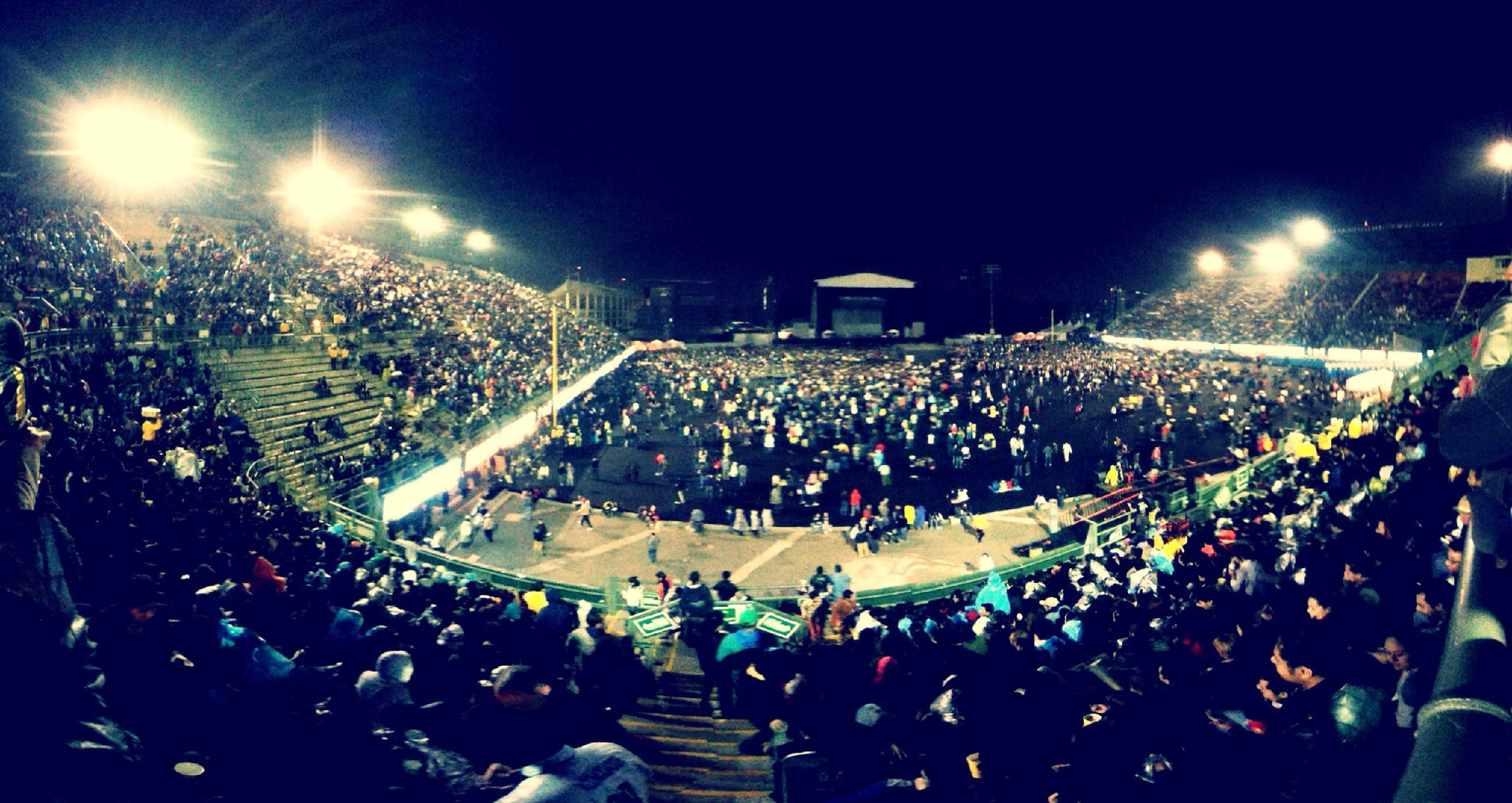 large group of people, crowd, illuminated, lifestyles, night, leisure activity, enjoyment, men, person, arts culture and entertainment, fun, celebration, event, togetherness, music, music festival, spectator, performance