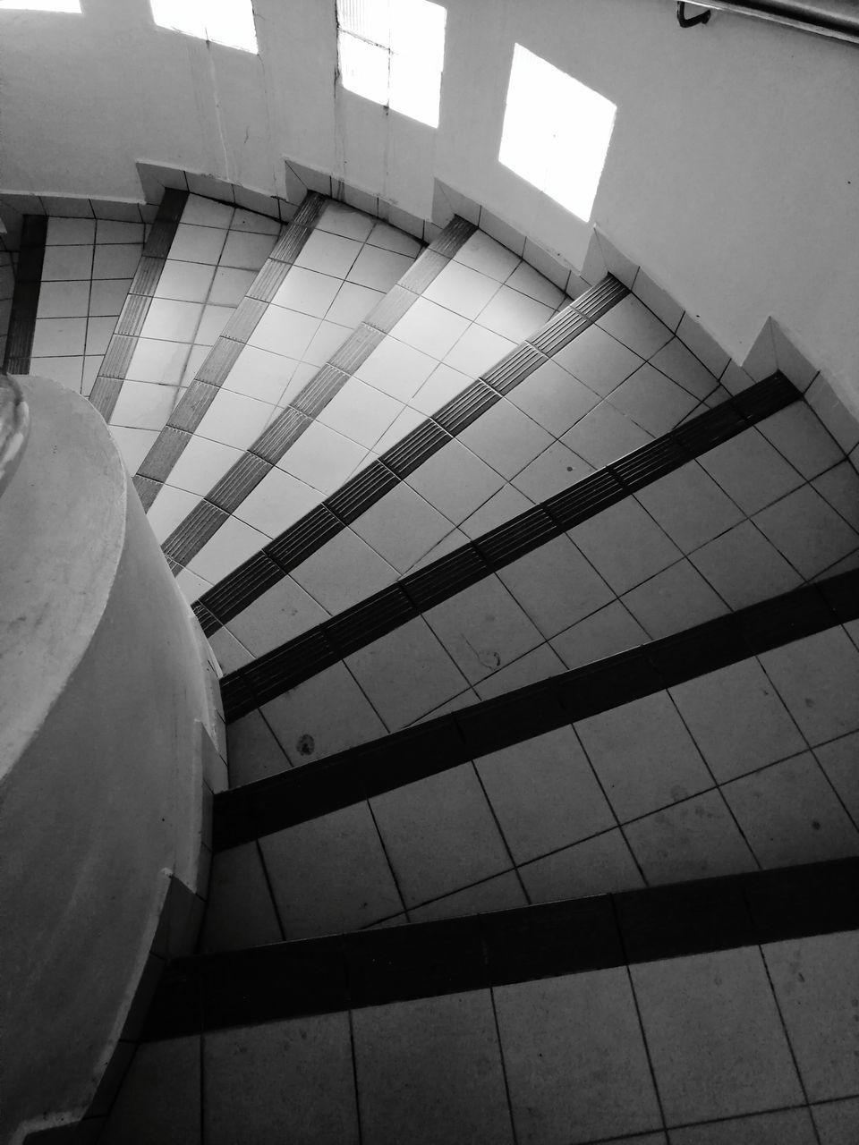 LOW ANGLE VIEW OF STAIRCASE ON FLOOR