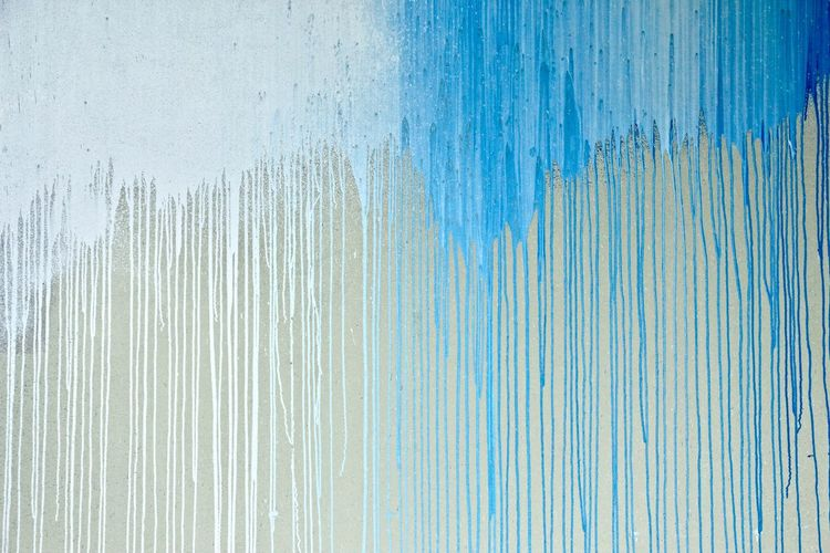 Shades of blue paint flowing down.