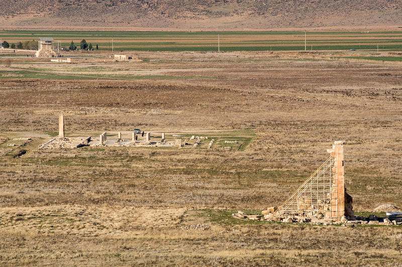 Ancient ruins on field seen from tomb of cyrus