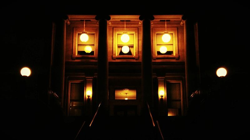 Globes of light above the west steps of the Idaho State Capitol at night. Boise Idaho Government Building Architecture Capitol Building