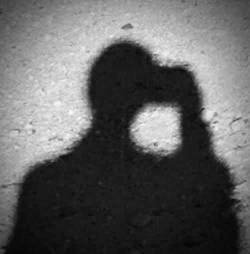 Shadow Me Caring A Camera Light And Shadow Light From Behind Screen Angle Out