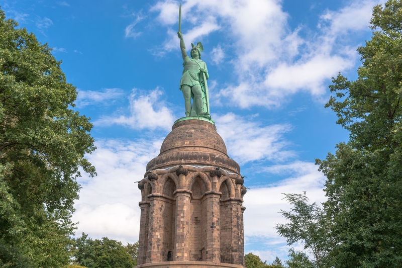 Statue of Cheruscan Arminius in the Teutoburg Forest near the city of Detmold, Germany. Archietcture Architecture Cloud - Sky Day Detmold Arminius Female Likeness Green Color Hermann Monument Hermann The Cherusker History Human Representation Low Angle View Memorial No People Outdoors Sculpture Sky Statue Travel Destinations Tree
