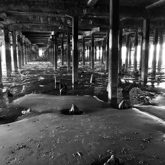 Under Pier Walton On The Naze Walton Black & White Tide Coming In