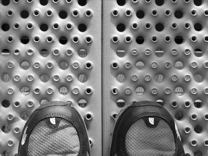 Catwalk. Bnw_friday_eyeemchallenge Circles Challenge Circles Shoes POV Point Of View Grid Pattern Textures And Surfaces Shadow Looking Down Holes Circles And Holes Photography Black And White Photography Black&white Bw Photography Bwphoto Malephotographerofthemonth From My Point Of View Monochrome Monochromatic Monochrome_Monday Monochrome _ Collection