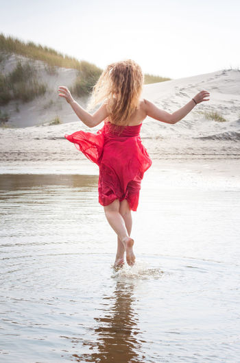 Dreaming Dreaming Away Having Fun Melancholic Red Dress Romantic Seagulls Summertime At The Beach Blond Hair Having A Good Time Horizon Horizon Over Water Meditative Melancholy One Person Outdoors Red Color Sea And Sky Seagulls And Sea Waterfront Waves Waves, Ocean, Nature Young Adult Young Women