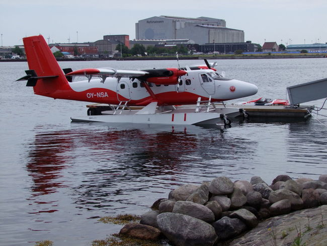 Sea Plane, Den Lille Havfrue Area Aeroplane Capital City Composition Copenhagen Den Lille Havfrue Denmark Full Frame Grey Sky No People Outdoor Photography Plane Red And White Colour Reflections In The Water Ripples In The Water Rocks Sea Seaplane Tourism Tourist Attraction  Tourist Destination Tranquil Scene Water