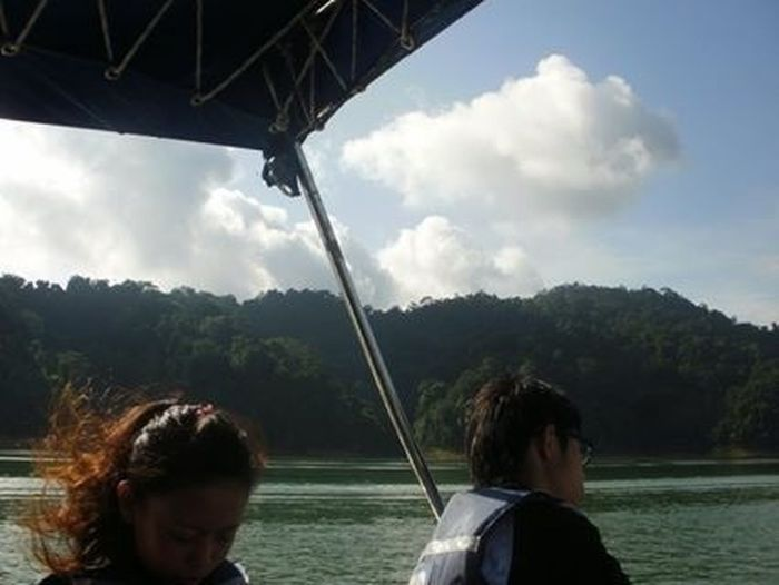 Hair in the wind cruising down Banding Lake in the morning. EyeEm Malaysia IPSNoFilter Nature