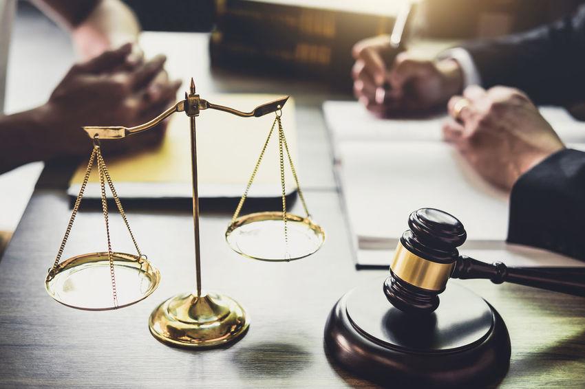Lawyer Adult Balance Barrister Body Part Business Consultant Counselor Customer  Fairness Gavel Hand Holding Human Body Part Human Hand Indoors  Inheritance Judge Judgement Justice Legal Legislation Men Occupation Verdict