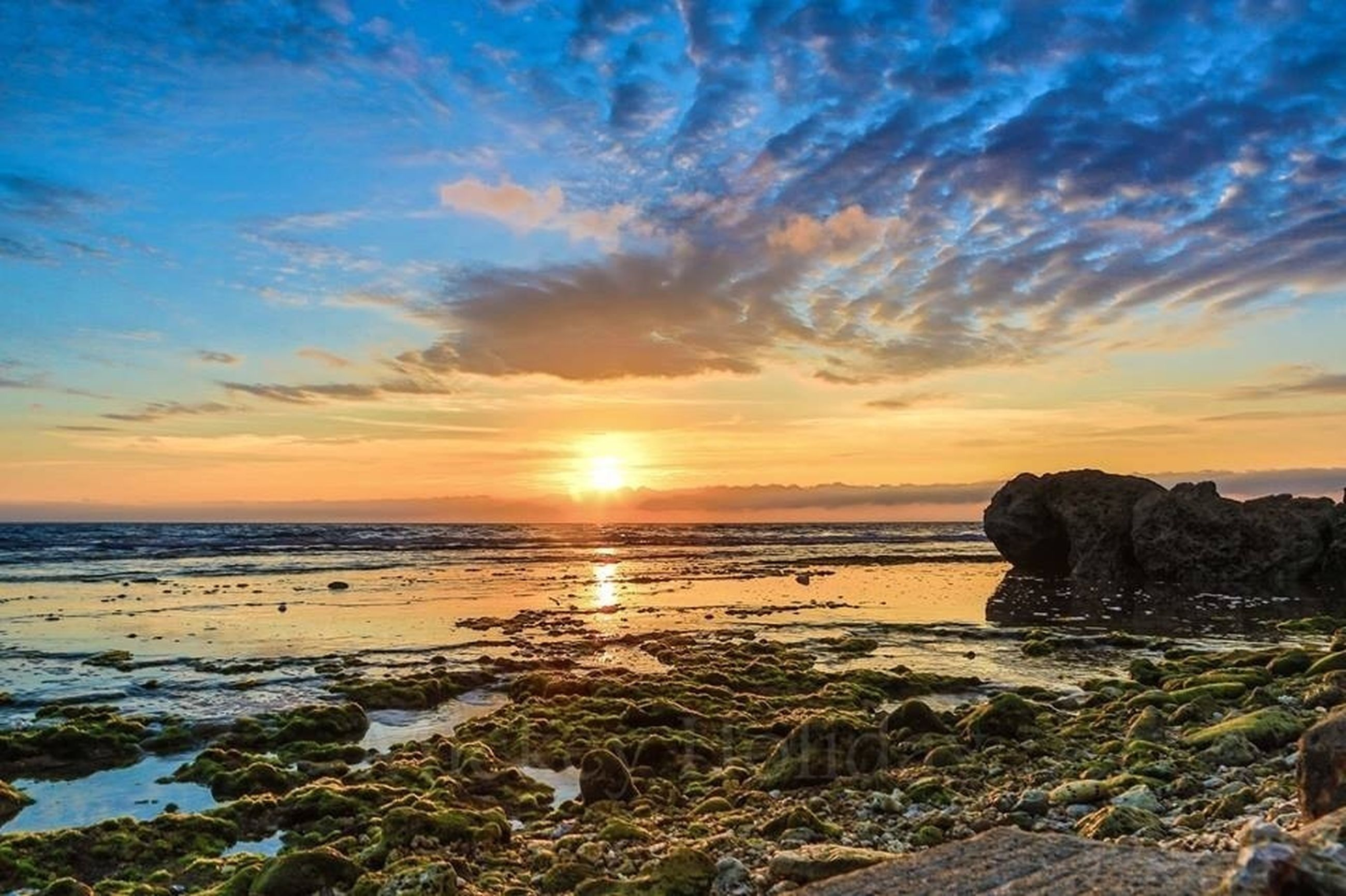 sunset, sea, scenics, water, tranquil scene, sky, beauty in nature, tranquility, beach, horizon over water, shore, sun, nature, cloud - sky, rock - object, idyllic, orange color, cloud, sunlight, non-urban scene