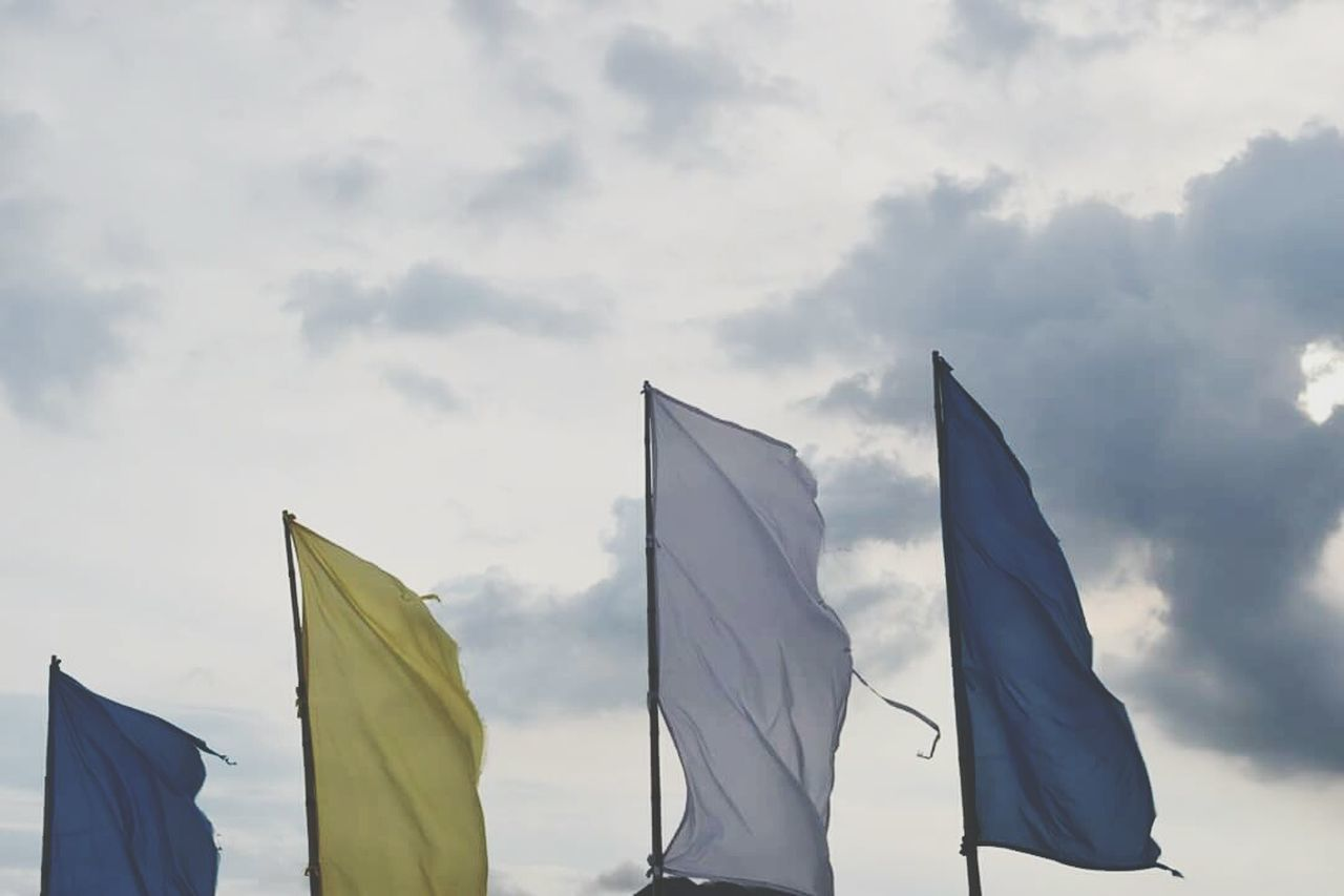 flag, patriotism, wind, outdoors, low angle view, day, sky, no people