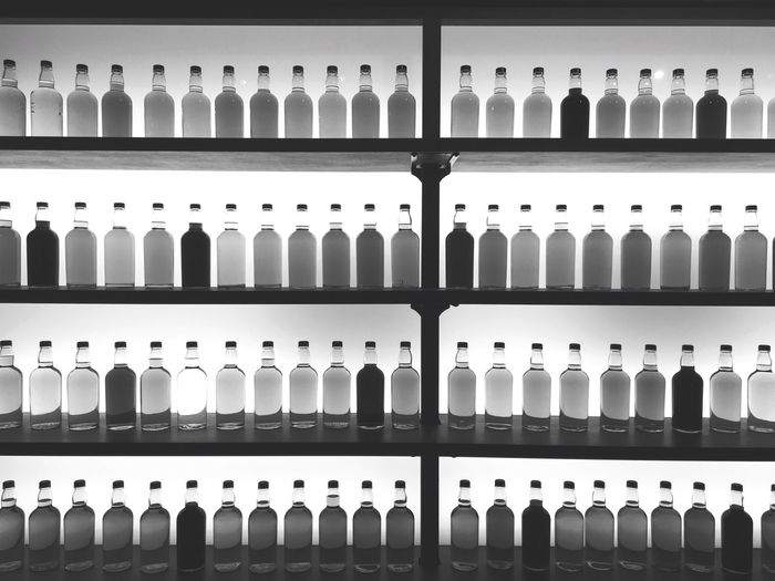 The Week Of Eyeem Shelf Full Frame In A Row Large Group Of Objects Repetition Backgrounds Indoors  No People Day Close-up Alcohol Bottle Suntory Blackandwhite Black & White Monochrome Monochrome Photography Bottles Umeda Www.w Restaurant