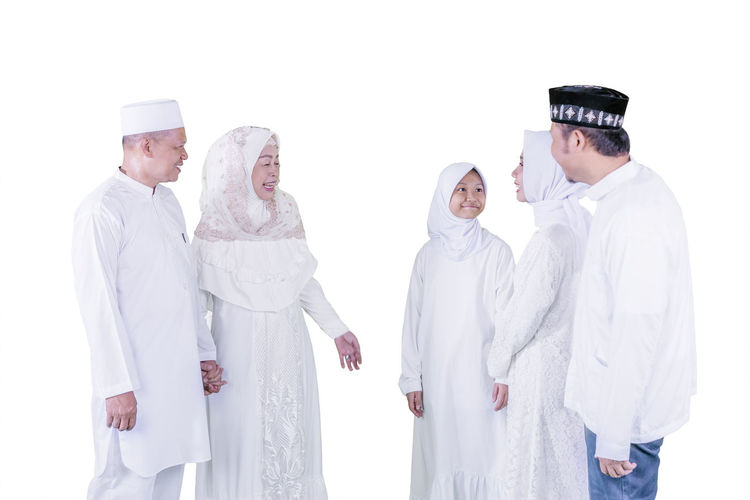 People standing against white background