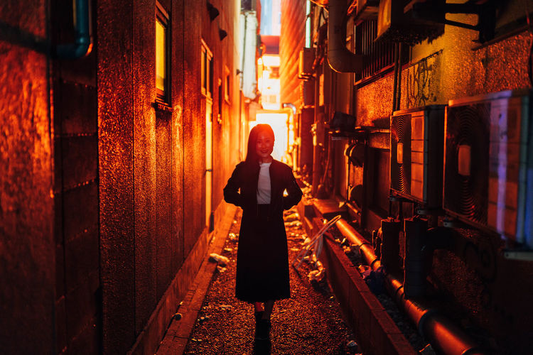 Woman standing in alley
