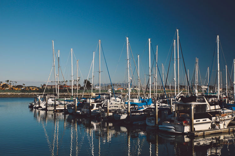 Architecture Blue Boat Clear Sky Day Harbor Marina Mast Mode Of Transport Moored Nature Nautical Vessel No People Outdoors Reflection Sailboat Scenics Sky Tranquility Transportation Water Waterfront Yacht