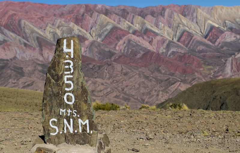 Information sign on rock in desert