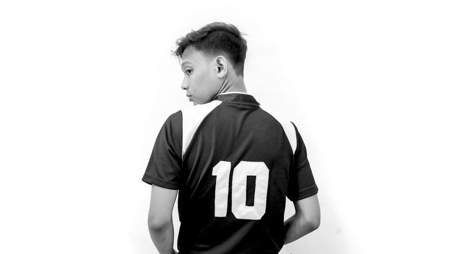 look at me Blackandwhite Sport Portrait White Background Child Sports Uniform Portrait Males  Studio Shot Aspirations Sports Clothing Confidence  Waist Up Soccer Uniform Cross Training The Modern Professional