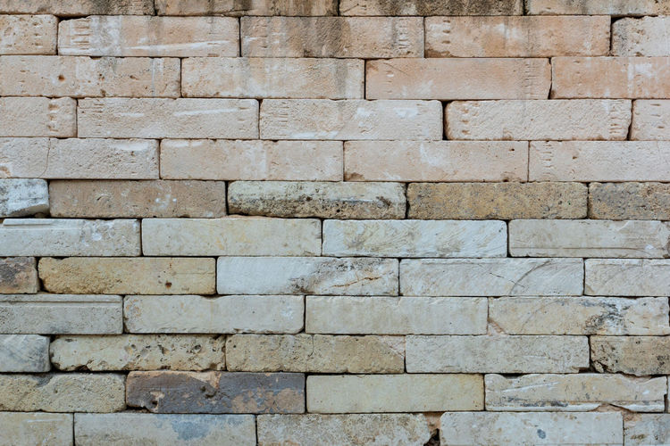Old beige brick wall background texture close up Backgrounds Full Frame Textured  Architecture Solid Wall Wall - Building Feature Pattern No People Built Structure Day Stone Wall Brick Rough Stone Material Outdoors Repetition Brick Wall Old Large Group Of Objects Concrete Brick Wall Stone