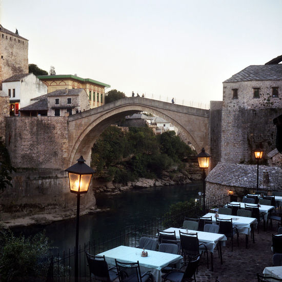 Architecture Balkan Bosnia And Herzegovina Evening Light Mostar Mostar Bosnia Mostar Bridge Mostar ♥ Old Town Quiet Moments Terrace Tourist Attraction  Arch Balkans Bridge Bridge - Man Made Structure Film Photography Illuminated Lamps Neretva Neretva River No People Outdoors Restaurant Travel Destinations EyeEmNewHere