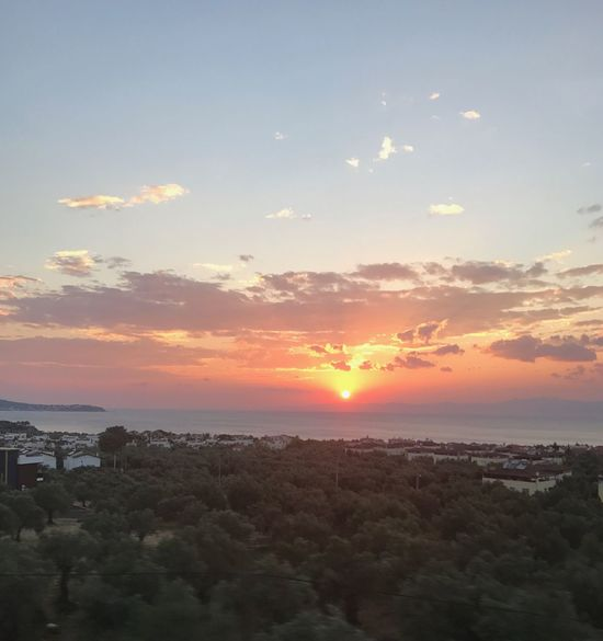 Sunset, sun shines, colours, I like sunsets and colours, clouds, shapes, sky, skyline, sea, trees, this is nature, natural, peace, relaxation, holiday, journey, on road watching sunset, nice view, Turkey