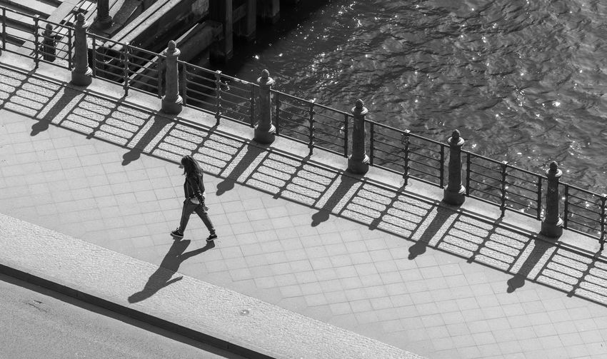 Black And White The Art Of Street Photography Water River Shadow Spread Wings Alone Lonely Railing Real People Full Length High Angle View Lifestyles Men One Person Day Leisure Activity Nature Architecture Sea Staircase Walking Outdoors Women