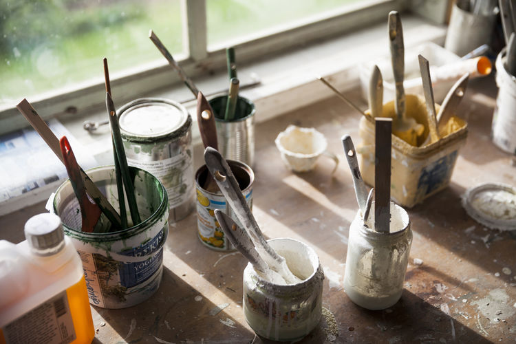 High angle view of paintbrushes in jar on table