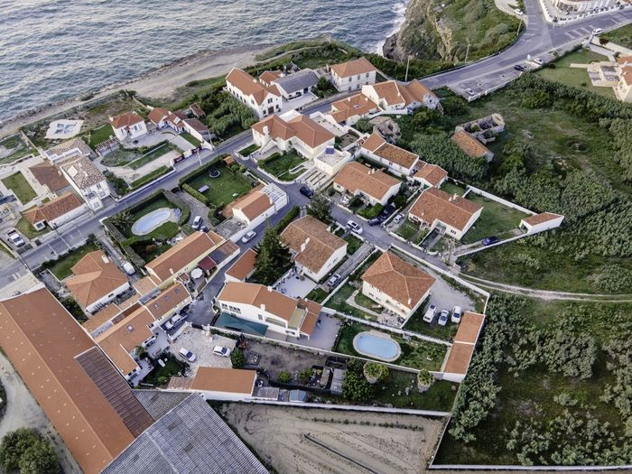 High angle view of buildings and houses in city
