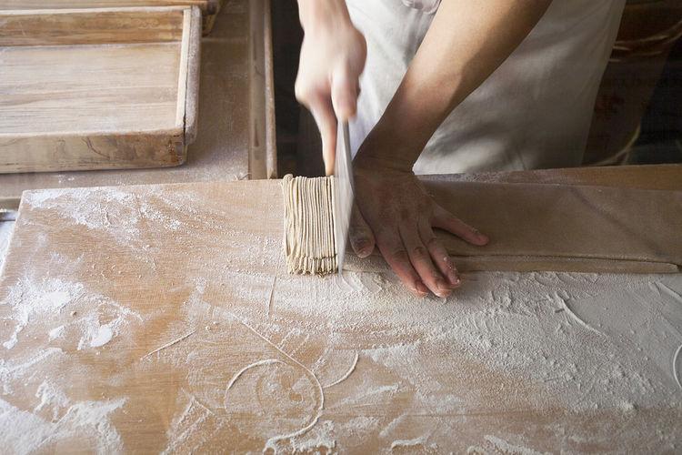 Woman Preparing Noodles