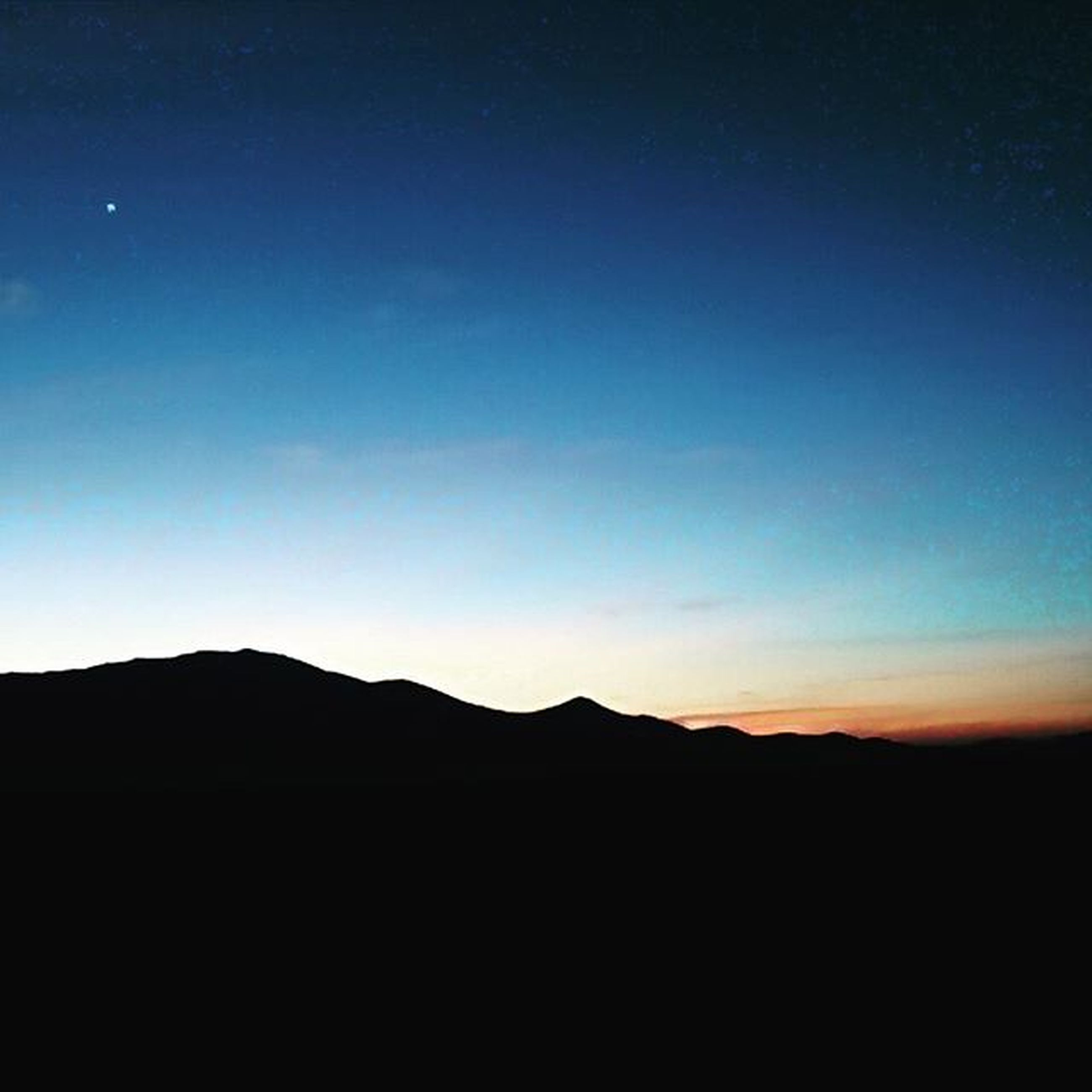 copy space, silhouette, tranquil scene, scenics, tranquility, mountain, clear sky, beauty in nature, mountain range, nature, landscape, blue, dark, idyllic, dusk, sunset, sky, non-urban scene, majestic, outline