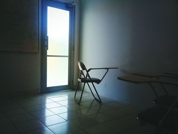 Board Classroom Moment Gloomy EyeEmNewHere EyeEm Selects Behind The Door Sad Lone Alone Bright Class Boring Class Boring Day At School Door Doorway Light And Shadow Chair Wall Photography Themes Window Architecture Room Closed Open Door