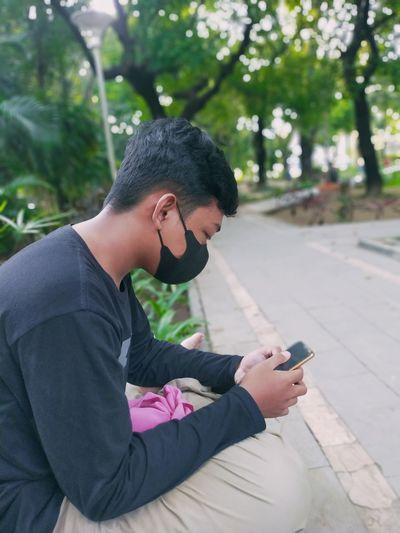 Side view of teenage girl using mobile phone