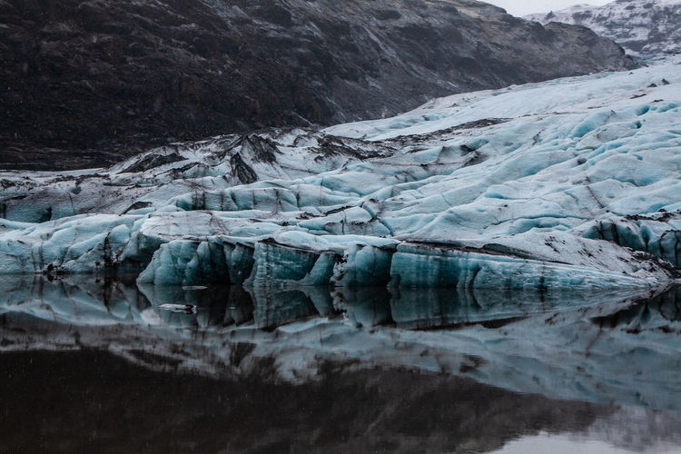 Scenic view of iceland glacier against sky and mountain during winter with reflections