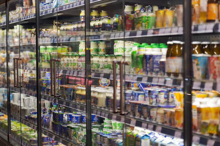 Full frame shot of bottles on display at store