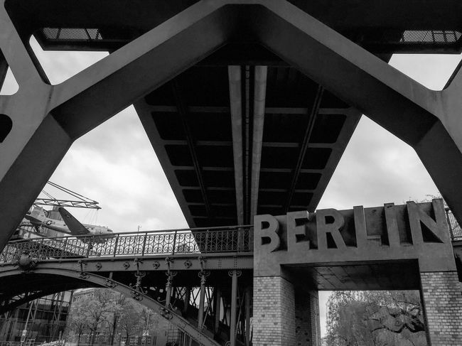 Bridge - Man Made Structure Connection Architecture Built Structure Engineering Low Angle View Transportation Day Below Outdoors Underneath No People Sky Black & White Blackandwhite Photography Black And White Blackandwhite Monochrome Streetphotography Monochrome Photography Berliner Ansichten Low Angle View City Architecture Street Photography